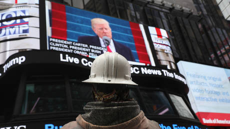 FILE PHOTO: People watch the televised inauguration of Donald Trump as the 45th President of the United States while in Times Square on January 20, 2017 in New York City