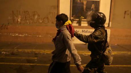 A police officer detains a man during protests in Lima, Peru on November 12, 2020. © REUTERS/Sebastian Castaneda