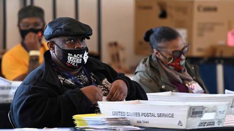 Election workers in Fulton County process ballots in Atlanta, Georgia, November 4, 2020.