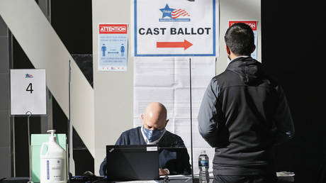 A poll worker checks the registration of a voter in Chicago, Illinois.