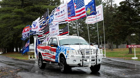 FILE PHOTO: A truck with flags attached is seen at a Bikers for Trump event in Scranton, Pennsylvania, November 1, 2020 © Reuters / Rachel Wisniewski