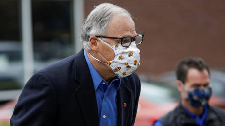 Washington Governor Jay Inslee is shown arriving at a Covid-19 training event in May.