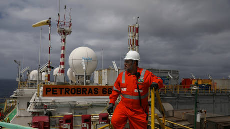 A worker walks on the heliport at the Brazil's Petrobras P-66 oil rig in the offshore Santos basin in Rio de Janeiro, Brazil