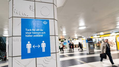 FILE PHOTO: A sign reminding people to respect social distancing at the Central Station in Stockholm, Sweden. © Amir Nabizadeh via REUTERS / TT News Agency