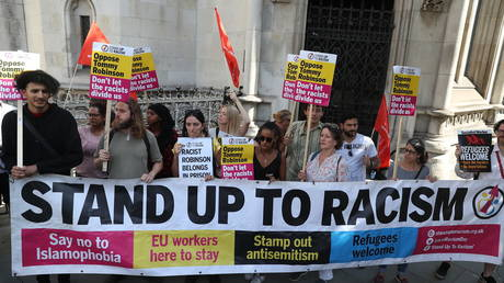 FILE PHOTO: Activists from the Stand Up To Racism campaign in London. August 2018. © AFP / Daniel Leal-Olivas