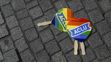 ACLU pride hearts lie on the ground during a rally in support of David Mullins and Charlie Craig after the United States Supreme Court ruled in favor of Jack Phillips, owner of Masterpiece Cakeshop, who refused to make a wedding cake for the same sex couple in 2012.