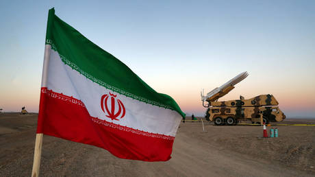FILE PHOTO: An Iranian flag is pictured near in a missile during a military drill, Iran. © West Asia News Agency via REUTERS
