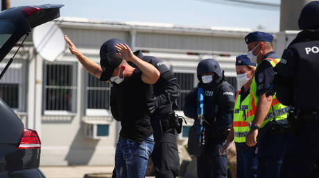 FILE PHOTO: Austrian and Hungarian police officers attend an exercise to prevent migrants from crossing the Austrian border from Hungary in Nickelsdorf, Austria, July 2, 2020.