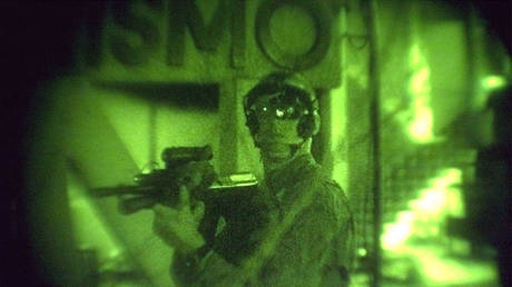 FILE PHOTO: An Australian soldier is seen through night vision while on patrol in Dili, East Timor.