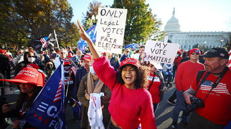 """FILE PHOTO: Supporters of US President Donald Trump participate in a """"Stop the Steal"""" protest after the 2020 US presidential election, in Washington, DC."""