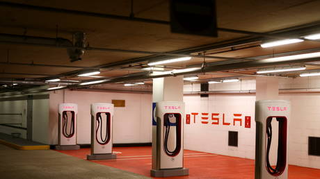 A Tesla electric charging point stands unused in a car park in UK