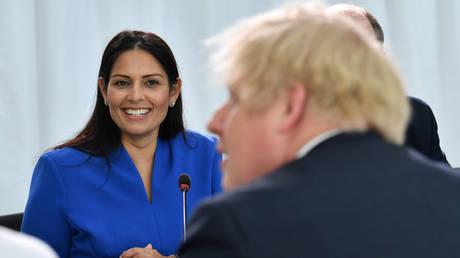 FILE PHOTO: UK Home Secretary Priti Patel looks on as Prime Minister Boris Johnson chairs a cabinet meeting on January 31, 2020. © Pool via REUTERS / Paul Ellis