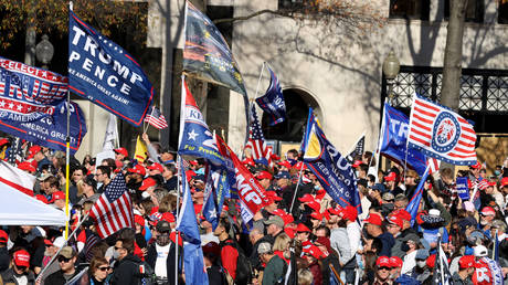 """People participate in the """"Million MAGA March"""" from Freedom Plaza to the Supreme Court, on November 14, 2020 in Washington, DC."""