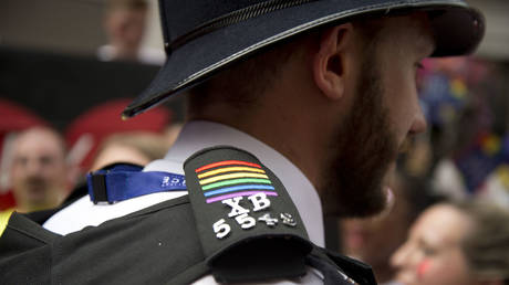 FILE PHOTO: A policeman at work on the parade has rainbow coloured stripes on his epaulette at Pride in London, formally known as Pride London, United Kingdom, 2017