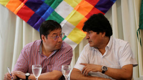 FILE PHOTO: Former Bolivian President Evo Morales (right) speaks to then-presidential candidate Luis Arce during a meeting in Buenos Aires, Argentina, February 17, 2020.