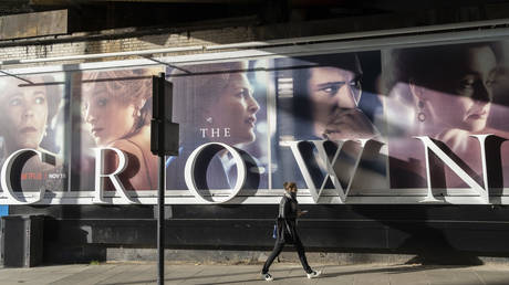 A panoramic billboard advertising the latest series of Netflix's 'The Crown' which is now airing on demand, shows the main characters of the British royal family on 12th November 2020, in London, England