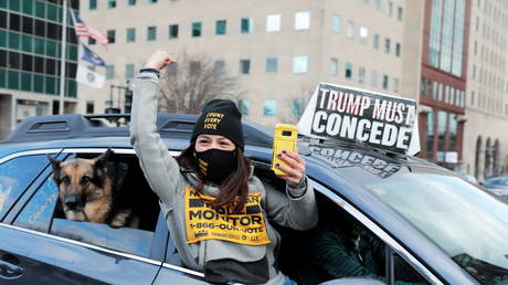 Demonstrators in a car caravan demand the Board of State Canvassers to certify the results of the election in Lansing, Michigan, US, November 23, 2020