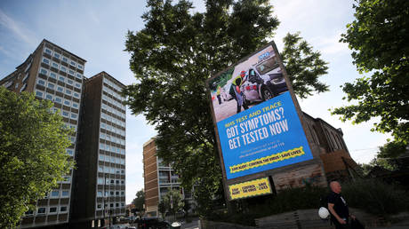 FILE PHOTO: A government and NHS Test and Trace advert is seen on a billboard in London. © REUTERS / Hannah McKay