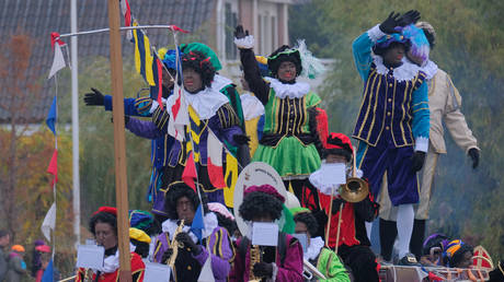FILE PHOTO: People dressed as traditional character known as Zwarte Piet or Black Pete arrive on a boat with Sinterklaas (St. Nicholas) November 24, 2018, in Katwijk, Netherlands