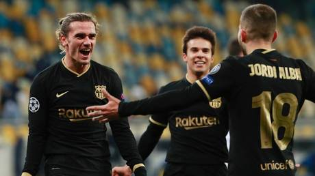 Antoine Griezmann celebrates netting Barca's fourth goal in their 4-1 Champions League win in Kiev