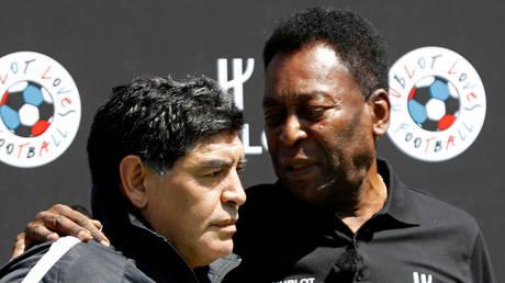 Football legends Pele and Diego Maradona © Charles Platiau