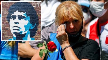 A fan mourns the death of Diego Maradona as fans flock to his wake in Buenos Aires