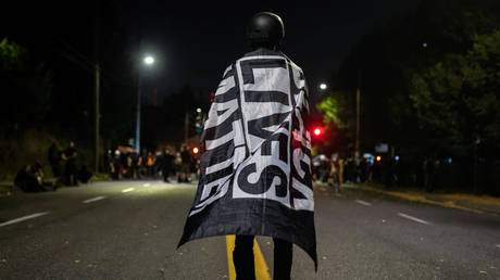 A protester takes part in a demonstration in Portland