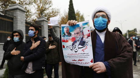 FILE PHOTO: Protesters rally against the killing of Mohsen Fakhrizadeh, in Tehran, Iran, on November 28, 2020.