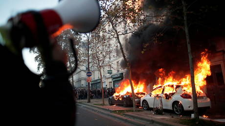 Cars burn during a demonstration against the so-called Global Security Bill in Paris, France, November 28, 2020