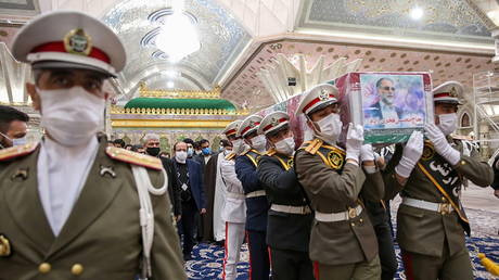Iranian forces carry the coffin of assassinated scientist Mohsen Fakhrizadeh at the Imam Khomeini's Shrine in Tehran on Sunday.