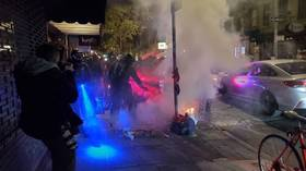 Protesters set fires & clash with NYC cops after hundreds turn out for 'Count Every Vote' march in Manhattan (PHOTOS & VIDEOS)