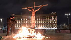 Scorching savior: Russian activist faces a month in jail after fiery crucifixion stunt outside Moscow's FSB headquarters