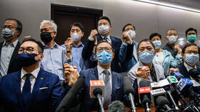 Hong Kong opposition lawmakers resign en masse after 4 colleagues expelled from city's parliament