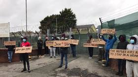 'We escaped from war to prison': Migrants protest after being housed in ex-military base in Wales (VIDEO)