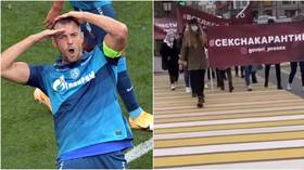'Time to speak openly about sex': Female protesters turn out in Moscow to support football star Dzyuba after X-rated video scandal
