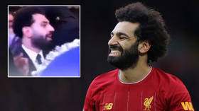 'Irresponsible' Salah slammed for dancing maskless at packed wedding as Liverpool star faces anxious wait for Covid-19 retest