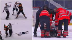 Worrying scenes as Slovak hockey player stretchered off after sickening one-punch KO from Canadian rival (VIDEO)