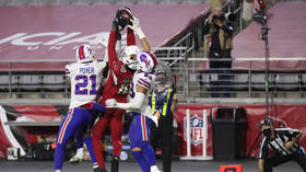 'He's a MONSTER': DeAndre Hopkins makes incredible LAST SECOND Hail Mary touchdown catch while surrounded by three players (VIDEO)