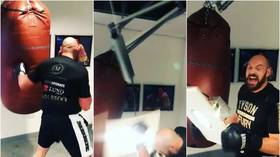 WATCH: 'That could have hurt me you f*cking idiot!' Shocking moment ROOF CAVES IN as Tyson Fury punches bag off hinges (VIDEO)