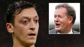'You've been FINISHED': Arsenal outcast Ozil sends fans into hysteria by slamming TV host Morgan during team's Premier League game