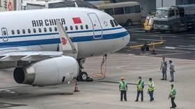 Hundreds of flights canceled following coronavirus outbreak at Shanghai airport