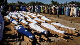 UN says at least 110 killed in suspected Boko Haram attack in Nigeria where many victims were beheaded