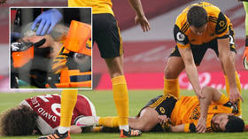 'We pray he's all right': Football star has operation on fractured skull after sickening collision horrifies brain injury experts