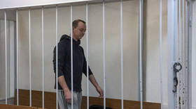 Russian journalist accused of selling secrets to NATO remanded in custody as treason investigation gets underway