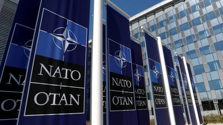 Banners displaying the NATO logo are placed at the entrance of new NATO headquarters (FILE PHOTO) ©  REUTERS/Yves Herman/File Photo