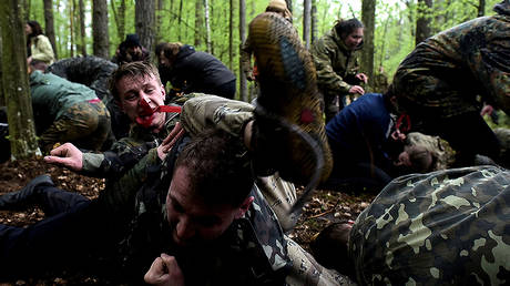 FILE PHOTO Participants take part in a practice hand-to-hand combat, during a military patriotic game of survival for youth, at the place of fighting between the Ukrainian Insurgent Army (UPA) and the Soviet NKVD secret police troops in April 1944, in Ternopil region, Ukraine, May 1, 2017