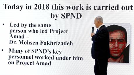 Israeli Prime Minister Benjamin Netanyahu is shown in a 2018 press briefing in Tel Aviv identifying Iranian scientist Mohsen Fakhrizadeh as a threat to Israel's security.