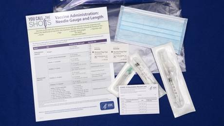 COVID-19 vaccination cards shown as part of Operation Warp Speed kit