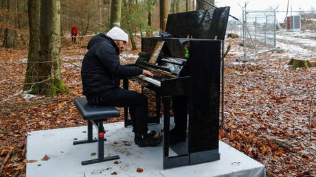 Pianist Igor Levit plays the piano during a protest action against the extension of the A49 motorway, near Dannenrod, Germany, on December 4, 2020.
