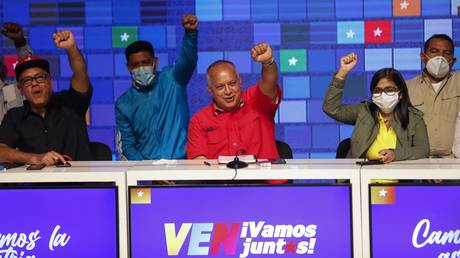 Members of the United Socialist Party of Venezuela raise their hands with a clenched fist in a sign of victory on December 7, 2020 in Caracas, Venezuela.
